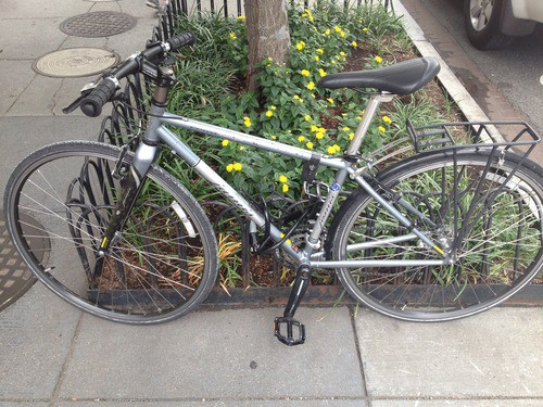 The photo of the bike, locked with someone else's lock near my office.